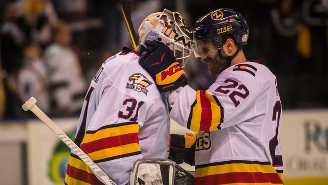 Colorado Eagles goaltender Joe Cannata (31) celebrates with teammate Ryan Harrison (22) after winning a 4-2 contest against the Wichita Thunder on Wednesday, April 18, 2018, at the Budweiser Event Center in Loveland, Colo.