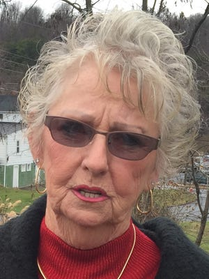 Mary Ann Hall says the person who came into her yard and removed her Christmas lights can pick up the electric cord they left behind.