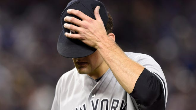 New York Yankees starting pitcher Nathan Eovaldi reacts as he leaves the field after the fifth inning of a baseball game against the Toronto Blue Jays on Thursday, April 14, 2016, in Toronto.