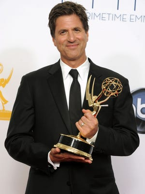 """Director Steven Levitan, winner of the Outstanding Directing for a Comedy Series award for """"Modern Family,"""" poses backstage at the 64th Primetime Emmy Awards at the Nokia Theatre in Los Angeles on Sept. 23, 2012."""
