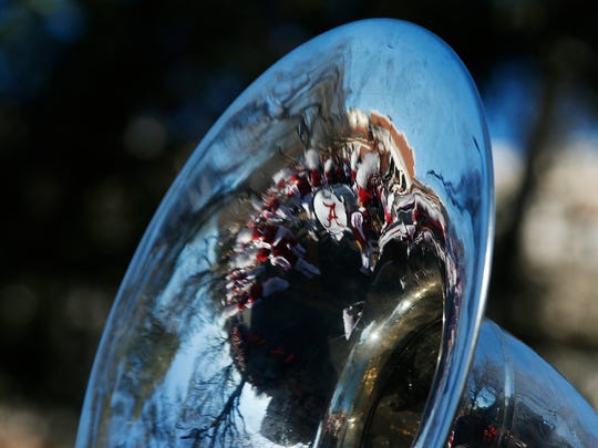 A University of Alabama band bass drum is seen inside the reflection of an Alabama tuba during the NCAA college football championship parade, Saturday, Jan. 20, 2018, in Tuscaloosa, Ala. Alabama won the national championship game against Georgia 26-23 in overtime. (AP Photo/Brynn Anderson)