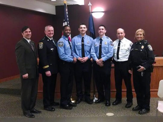 Officer Issac McGee, third from left, joined the Gates Police Department this year. He is the first African-American officer in Gates.