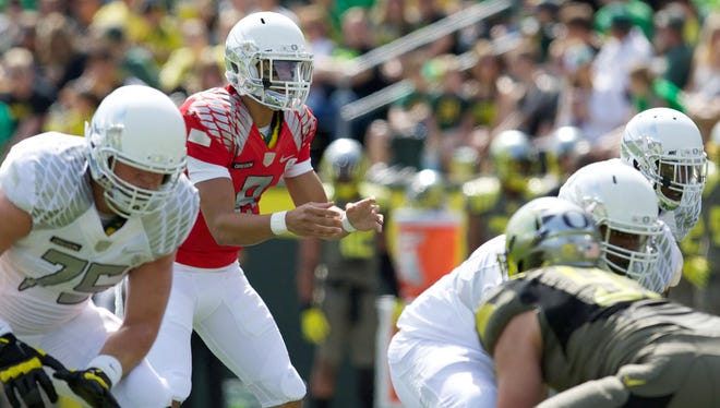 Oregon quarterback Marcus Mariota, shown here in the Ducks' spring game, could run the offense at an even faster rate under new coach Mark Helfrich and coordinator Scott Frost this season.