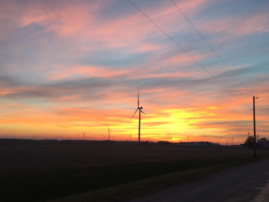 The sun sets on the Headwaters Wind Farm in Randolph