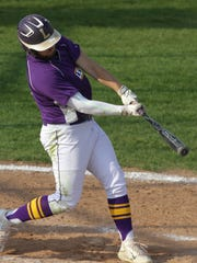 Lexington's Owen Murray swings at the ball while playing a home game on Friday against Tiffin Columbian.