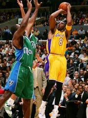LOS ANGELES - DECEMBER 20:  Kobe Bryant #32 of the Los Angeles Lakers makes a jump shot in the third quarter of the game against the Dallas Mavericks on December 20, 2005 at the Staples Center in Los Angeles, California. Bryant scored a personal best of 62 points during the game. NOTE TO USER: User expressly acknowledges and agrees that, by downloading and/or using this photograph, user is consenting to the terms and conditions of the Getty Images License Agreement.  (Photo by Robert Laberge/Getty Images)