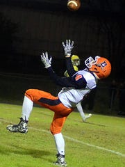 Beech High sophomore Ty Dean catches a deflected pass