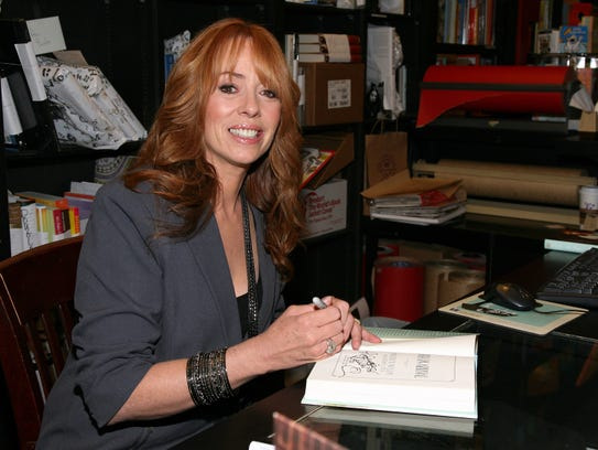Mackenzie Phillips attends a signing for her book 'High