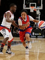 Mo'ne Davis, right, drives past Kevin Hart, during the first half of the NBA All-Star celebrity basketball game Friday, Feb. 13, 2015, in New York. (AP Photo/Frank Franklin II)