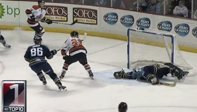 Toledo Walleye goalie Jeff Lerg makes a spectacular save in overtime.