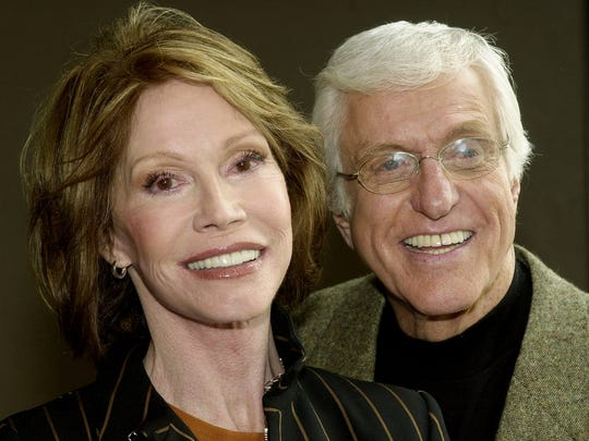 "Mary Tyler Moore and Dick Van Dyke pose together following a press conference announcing their reunion in a new television adaptation of the play, ""The Gin Game,"" part of the drama series ""PBS Hollywod Presents,"" in Los Angeles' Hollywood district Thursday, Jan. 9, 2003.  The production marks the first time that Moore and Van Dyke have acted together since their original teaming in the classic comedy series ""The Dick Van Dyke Show"" in the 1960s.  The show is set to air in Spring, 2003.  (AP Photo/stf)"