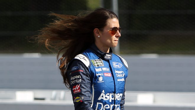 Danica Patrick confronted fans after they booed her for not signing autographs.