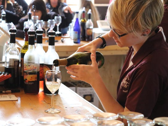 Taylor Eging, of the Put-in-Bay Winery, serves up a