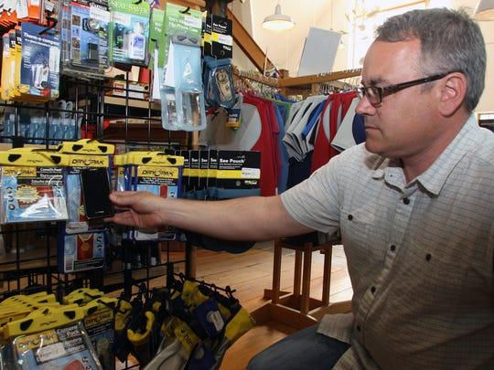 John Durrua, owner of the Jersey Paddler, looks over