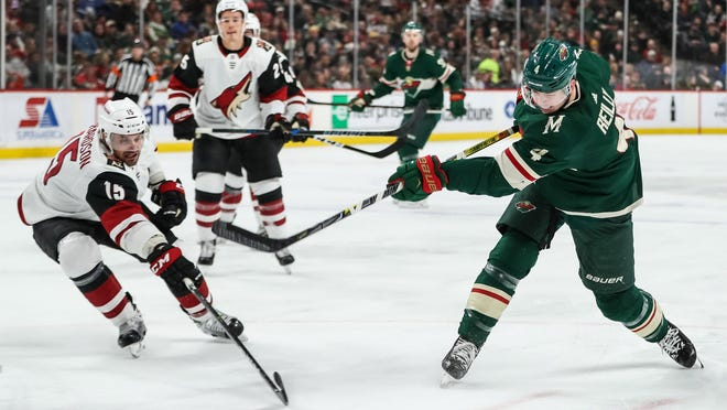 Feb 8, 2018; Saint Paul, MN, USA; Minnesota Wild defenseman Mike Reilly (4) shoots and scores a goal during the second period against the Arizona Coyotes at Xcel Energy Center. Mandatory Credit: Brace Hemmelgarn-USA TODAY Sports