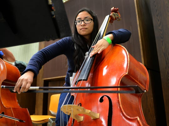 Andrea Medina Diaz plays bass at orchestra rehearsal during summer music camp at the University of Wisconsin-Green Bay on Thursday.