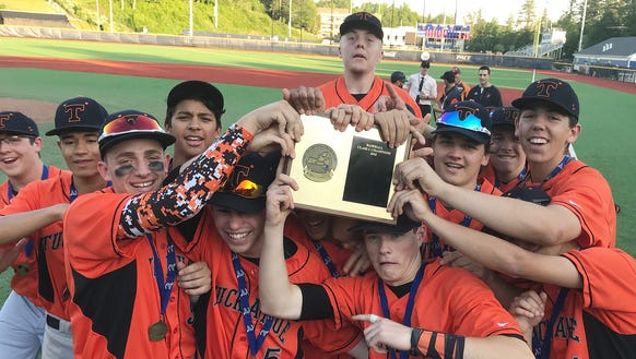 Tuckahoe players celebrate with the Section 1 plaque