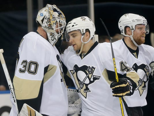 Pittsburgh Penguins goalie Matt Murray (30) is congratulated by left wing Conor Sheary (43) after recording a shutout in the Penguins' 5-0 win over the New York Rangers in Game 4 of an NHL hockey first-round Stanley Cup playoff series, Thursday, April 21, 2016, in New York. (AP Photo/Julie Jacobson)