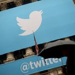 This November 7, 2013 file photo shows the logo of Twitter  on the front of the New York Stock Exchange (NYSE) in New York.
