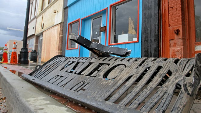 A city of Aztec bench, pictured Tuesday, was destroyed after a vehicle smashed into the Three Rivers Aikido storefront in Aztec on Monday.