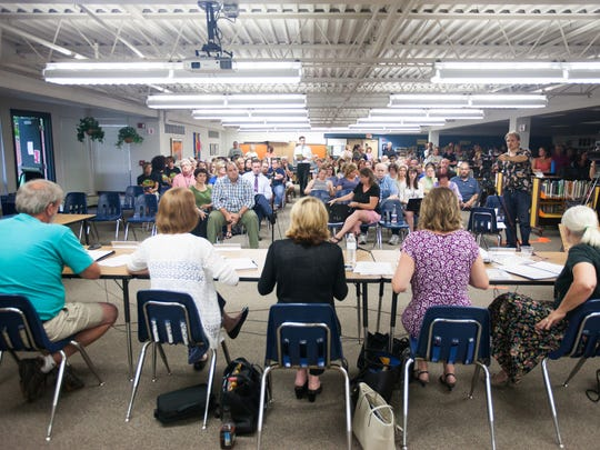 Milton Town School Board members sit in front of a sizeable crowd as a public meeting wraps up in Milton, Monday August 10, 2015.  Members of the community were given the opportunity to make comments at the meeting regarding the latest internal investigation report where 5 district employees allegedly failed to follow local hazing or bullying reproting policies.