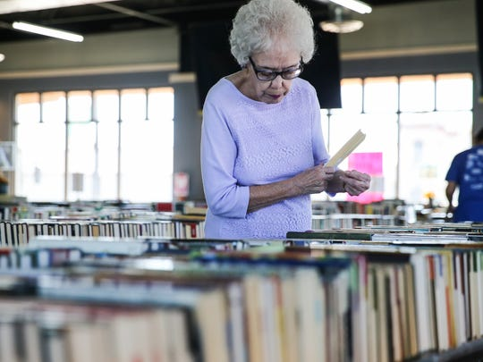 Carolyn Utt organizes books for the Best Little Book Sale in Texas Thursday, Oct. 26, 2017, at 511 N. Chadbourne St. in San Angelo.