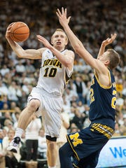 Iowa Hawkeyes guard Mike Gesell (10) goes to the basket as Michigan Wolverines guard Duncan Robinson (22) defends during the second half at Carver-Hawkeye Arena. Iowa won 82-71.
