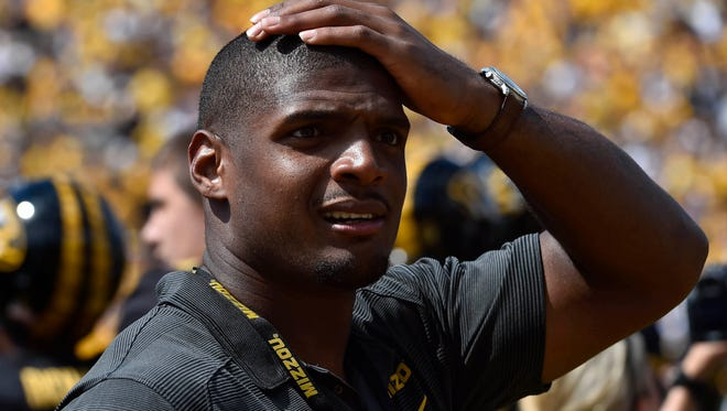 NFL rookie Michael Sam stands on the sidelines at a Mizzou game Aug. 30.