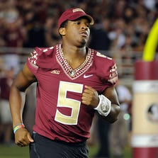 Sep 20, 2014; Tallahassee, FL, USA; Florida State Seminoles quarterback Jameis Winston (5) runs on to the field after halftime before the start of the second half of the game against the Clemson Tigers at Doak Campbell Stadium.