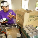 Volunteer Denese Sutton puts canned goods in a box while preparing food packages at Mount Carmel Baptist Church. The church has received shipments of food, medical and household and cleaning supplies from all across the country to distribute to victims of Hurricane Katrina.