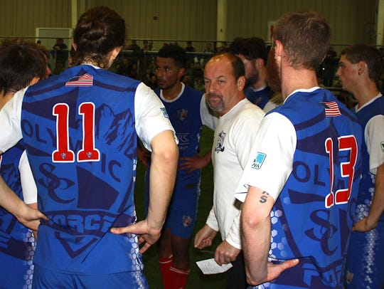 Olympic Force coach Steve Cashmore talks to his team