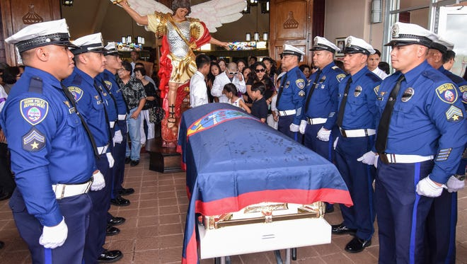 A Mass of Christian Burial was held for the late Guam Police Department Sgt. Elbert Piolo at the Santa Barbara Catholic Church in Dededo on July 25.