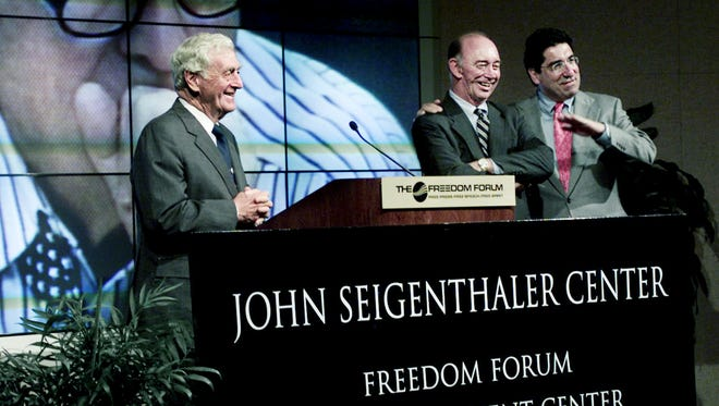 John Seigenthaler, left, nationally acclaimed newspaper editor and First Amendment advocate, had the First Amendment Center named after him by Vanderbilt University on July 26, 2002. Nicholas S. Zeppos, right, Vanderbilt provost and vice chancellor for academic affairs, and Charles Overby, center, chairman and CEO of the Freedom Forum, made the announcement.