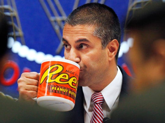 Federal Communications Commission (FCC) Chairman Ajit Pai takes a drink from a mug during an FCC meeting where the FCC will vote on net neutrality, Dec. 14, 2017, in Washington.