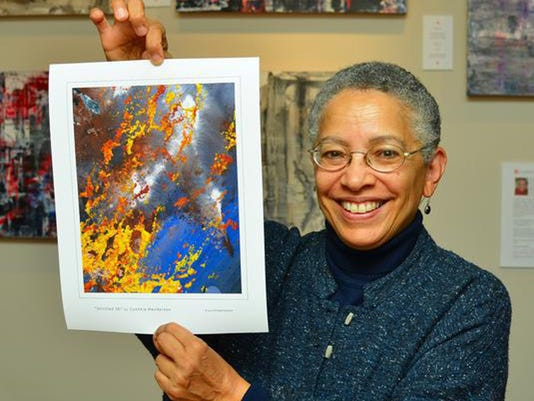 636221306692741551-Cynthia-Henderson-with-FIre-Ice-Print.jpg