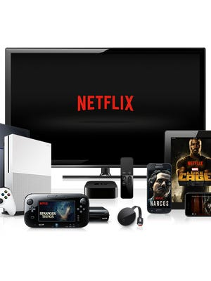 Netflix logo on TV with other devices that support the streaming service.