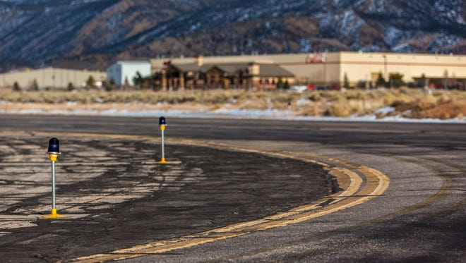 Faded lines and cracks are visiable at Cedar City Regional Airport, Friday, Jan. 22, 2016.