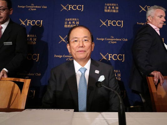 "Tokyo Organizing Committee of Tokyo 2020 Olympics CEO Toshiro Muto takes a seat at the start of a press conference at the Foreign Correspondents' Club of Japan in Tokyo, Tuesday, July 18, 2017. Muto said that uncertainty over the final budget will continue until 2019, the year before the Summer Games. ""We will continue to explore more cost efficiencies,"" Muto told the foreign media amid concerns regarding the higher-than-projected costs. (AP Photo/Shizuo Kambayashi)"