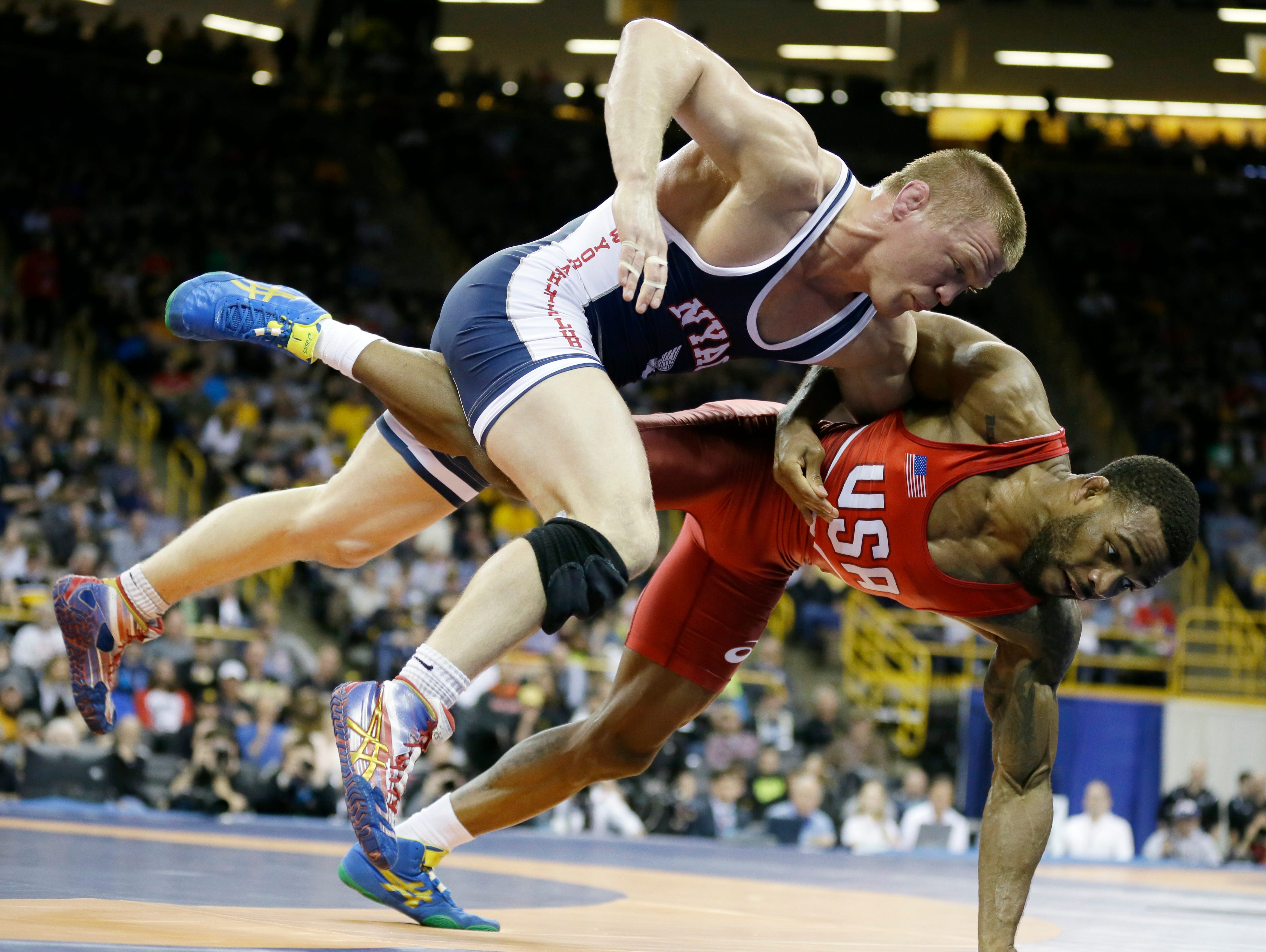 Andrew Howe (left) tries to take Jordan Burroughs to the mat during their 163-pound freestyle match at the U.S. Olympic wrestling team trials April 10, 2016, in Iowa City, Iowa.