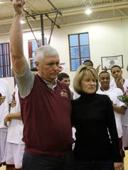 Bob Hurley and his wife, Chris, are congratulated for