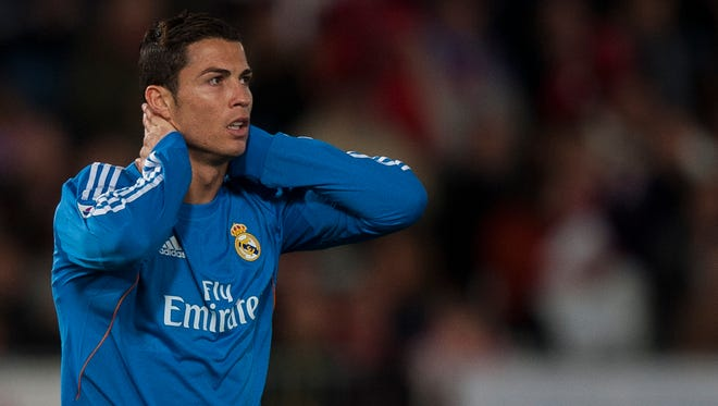 Real Madrid's Cristiano Ronaldo from Portugal reacts after failing to score during a Spanish La Liga soccer match in Almeria, Spain, Saturday, Nov. 23, 2013.