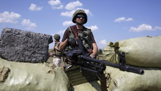A Ukrainian soldier mans a checkpoint in the eastern city of Debaltseve on Aug. 6, 2014.