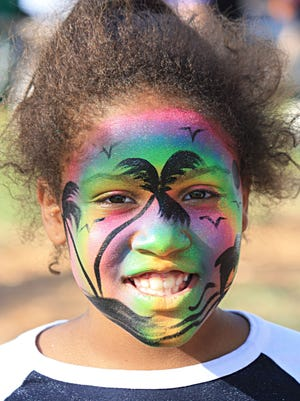 Olivia, 8, loves her face paint received at the 92nd annual Jupiter Jubilee, held from 11 a.m. to 5 p.m. on Saturday, Feb. 4 at the Jupiter Community Center.