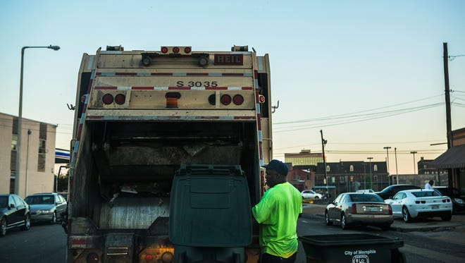 July 10, 2017 - Steve London, an employee with City of Memphis' Solid Waste Management, collects trash in downtown Memphis in this file photo.