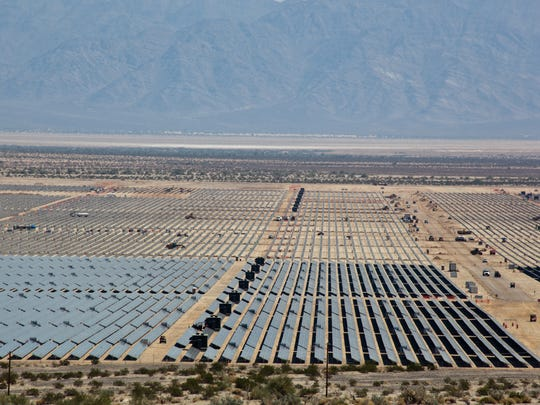 The Desert Renewable Energy Conservation Plan could transform how solar, wind, geothermal and transmission projects are sited across the state. In this file photo, solar panels at the 550-megawatt Desert Sunlight project extend across land in eastern Riverside County.