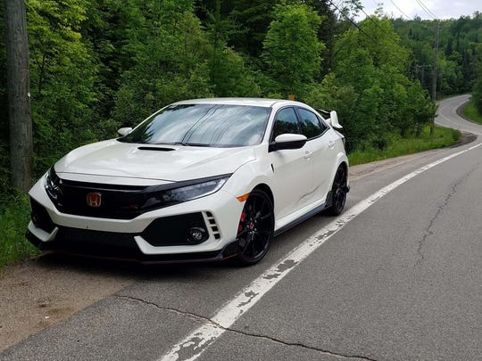 With heavy mascara and lots of body sculpting, the Honda Civic Type R cuts a distinctive figure.