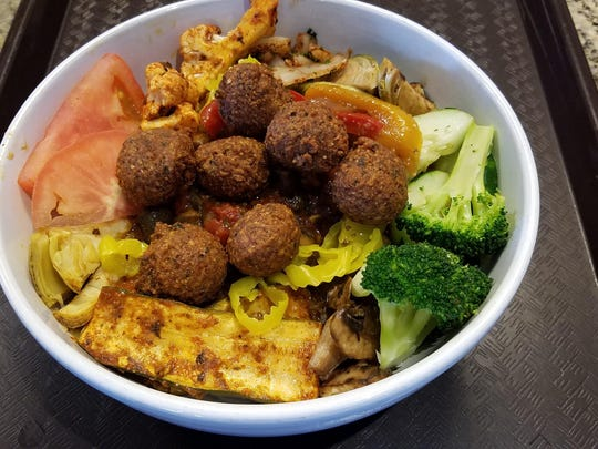 Basha's grain bowl with falafel and baby okra sauce.