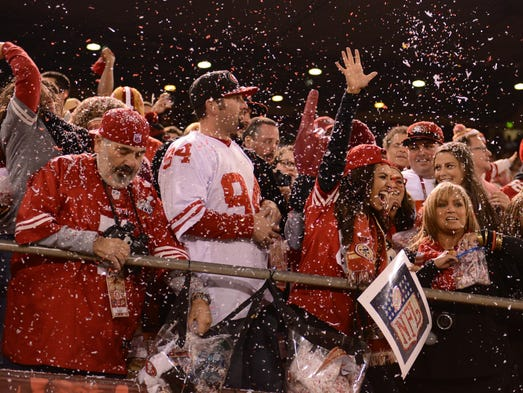 San Francisco 49ers fans celebrate after the 49ers made a field goal during the first quarter in the final regular season game against the Atlanta Falcons at Candlestick Park.