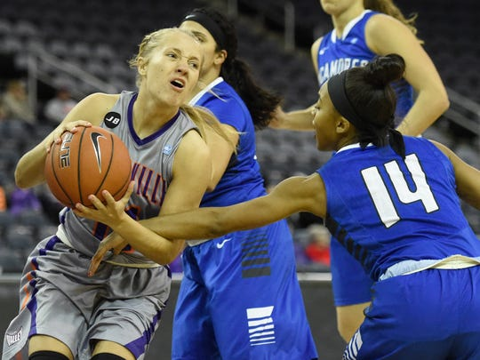 Brooke Dossett of the University of Evansville is fouled by Tierra Webb of Indiana State during the first quarter of the game at the Ford Center in Evansville Friday.