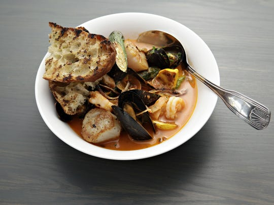 The bouillabaisse at Little Cleo's is a well-stocked shellfish stew.